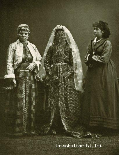 23- An Armenian woman in bridal dress between a Greek and a Jewish woman (<em>Elbise-i Osmaniye</em>, 1873)