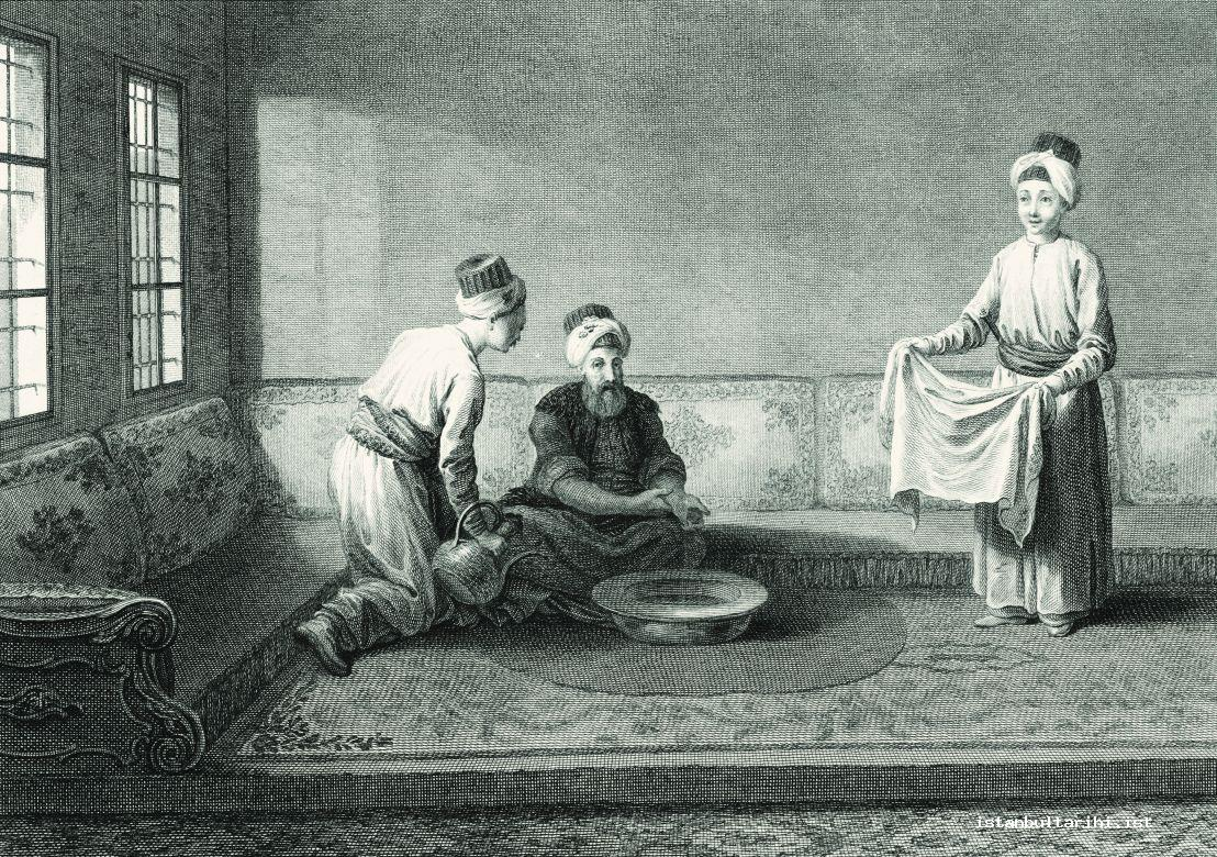 9- Holding water ewer and towel to an old man performing ablution in an Istanbul mansion (d'Ohsson)