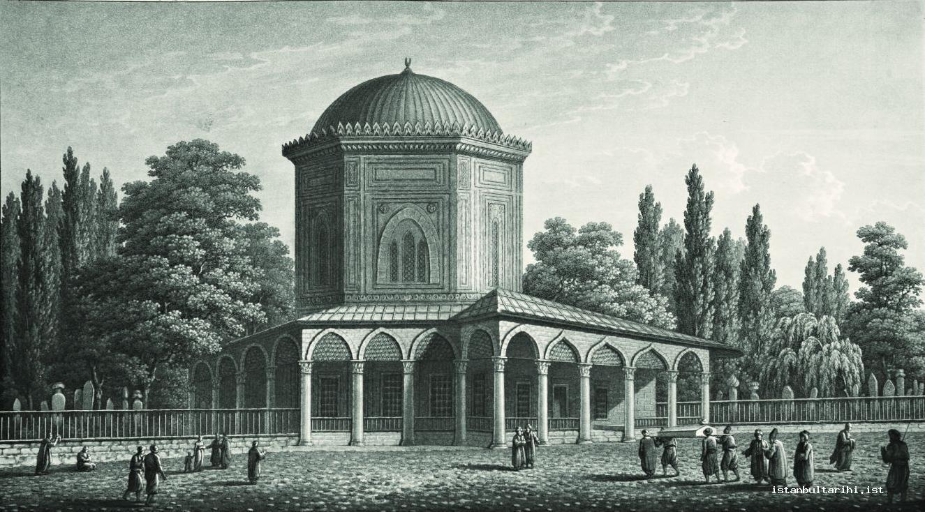 14- A funeral taken to burial in the fenced graveyard of Süleymaniye Mosque, in front of the tomb of Sultan Süleyman I (Pertusier)